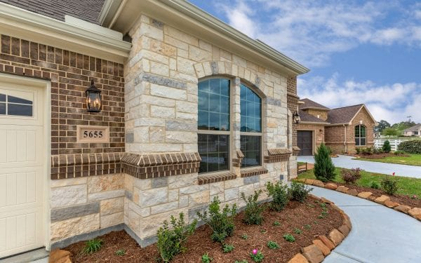 55+ Community Home Exterior with Brick and Stone