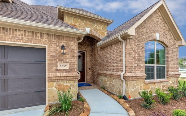 55+ Community Home Exterior with Stone Features