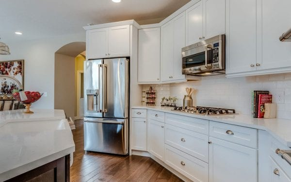 55+ Community White Cabinets with Stainless Steel